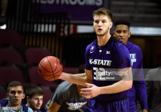 Dean Wade of the Kansas State Wildcats looks on with the ball against the George Washington Colonials during the 2017 Continental Tire Las Vegas...