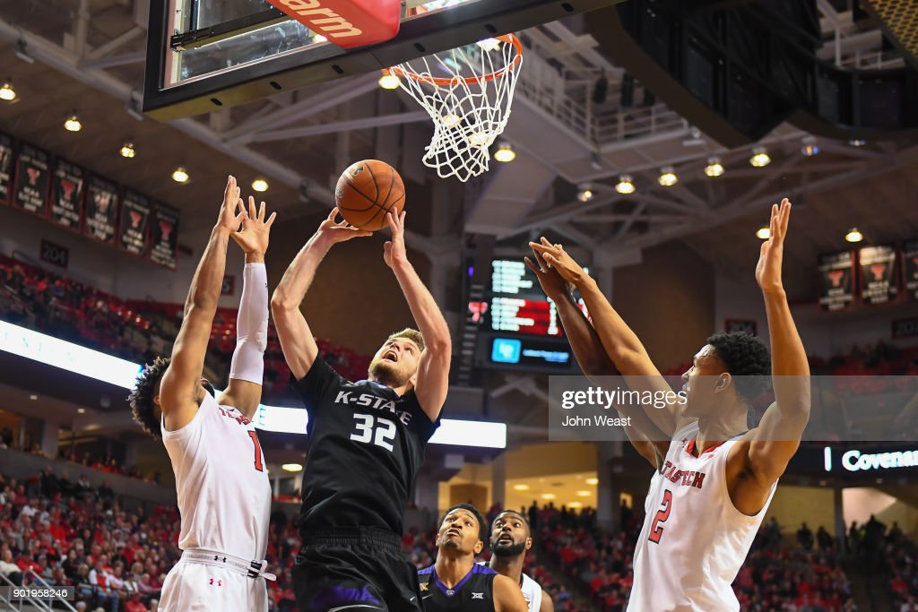 Dean Wade #32 of the Kansas State Wildcats shoots the ball against Brandone Francis #1 of the Texas Tech Red Raiders during the game on January 6, 2018 at United Supermarket Arena in Lubbock, Texas. Texas Tech won the game 74-58.