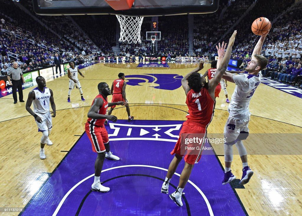Dean Wade #32 of the Kansas State Wildcats shoots the ball over Yante Maten #1 of the Georgia Bulldogs during the first half on January 27, 2018 at Bramlage Coliseum in Manhattan, Kansas.