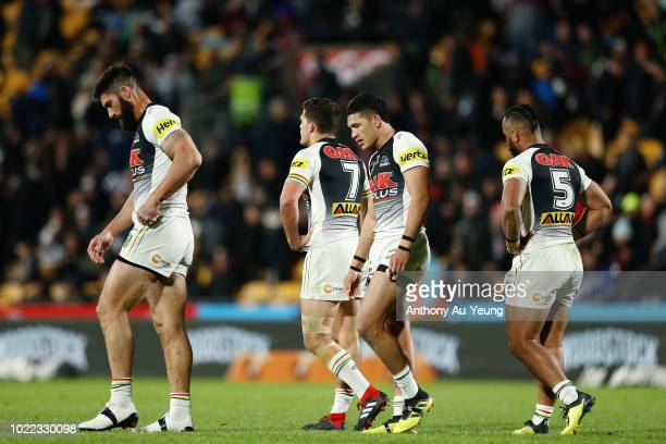 Dean Whare James Tamou Nathan Cleary and Christian Crichton of the Panthers walk off the field at the halftime break during the round 24 NRL match...