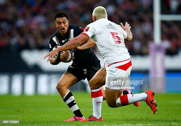 Dean Whare of New Zealand avoids a tackle from Ryan Hall of England during the International Rugby League Test Series match between England and New...