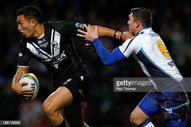 Dean Whare of New Zealand in action with Danny Brough of Scotland during the Rugby League World Cup Quarter Final match between New Zealand and...