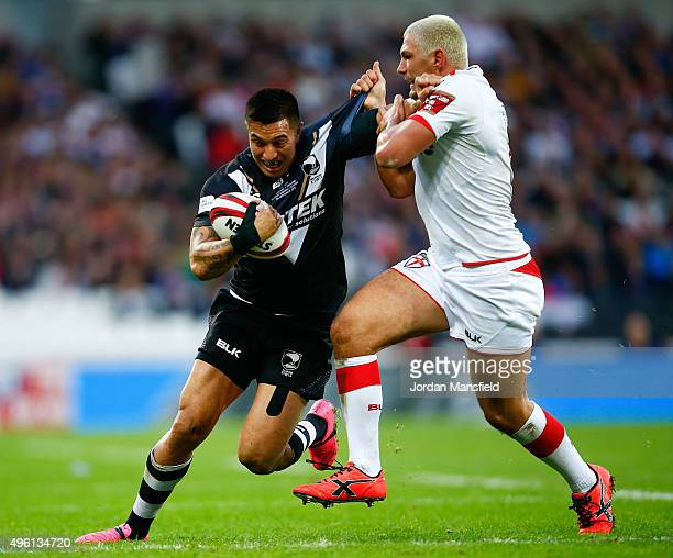 Dean Whare of New Zealand is tackled by Ryan Hall of England during the International Rugby League Test Series match between England and New Zealand...