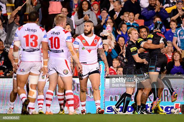 Dean Whare of the Panthers celebrates with team mates after scoring his teams first try during the round 14 NRL match between the Penrith Panthers...