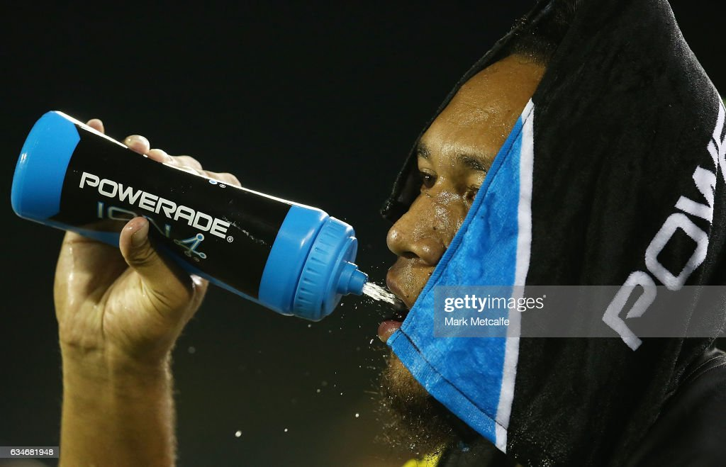 Dean Whare of the Panthers cools down with a wet towel and a drink during the NRL Trial match between the Canterbury Bulldogs and the Penrith Panthers at Belmore Sports Ground on February 11, 2017 in Sydney, Australia.