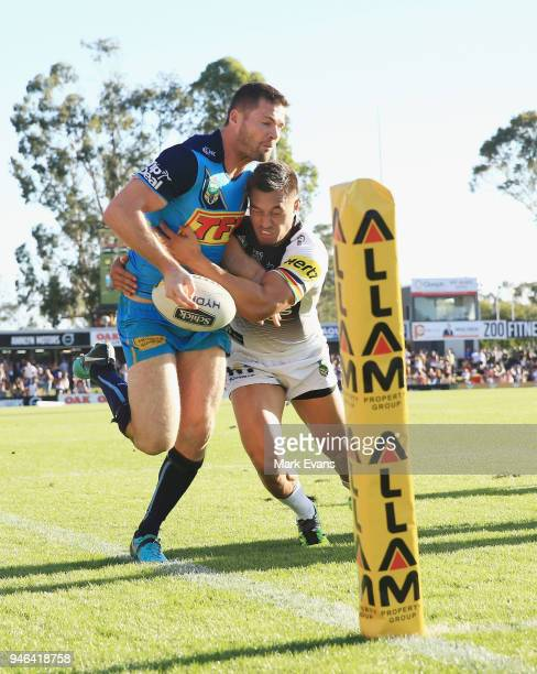 Dean Whare of the Panthers forces Anthony Don of the Titans into touch just short of the tryline during the round six NRL match between the Penrith...