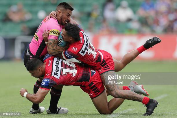 Dean Whare of the Panthers is tackled by Brayden Wiliame and Jayden Sullivan of the Dragons during Day 2 of the 2020 NRL Nines at HBF Stadium on...