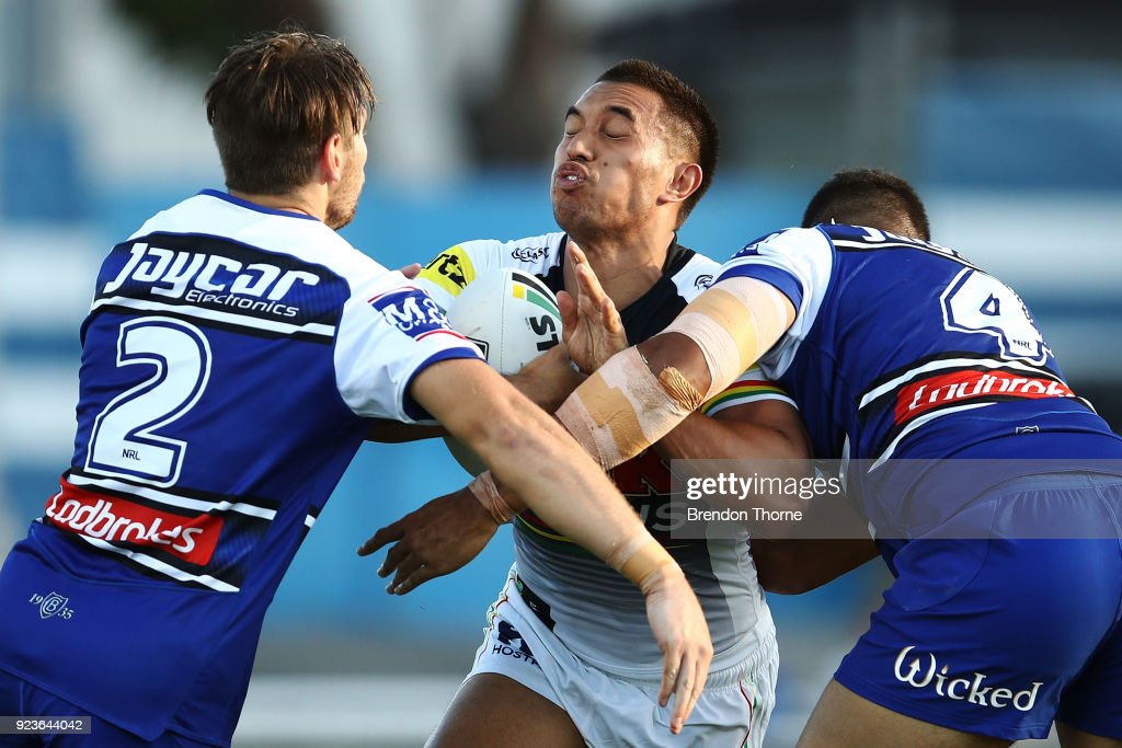 Dean Whare of the Panthers is tackled by the Bulldogs defence during the NRL trial match between the Penrith Panthers ands the Canterbury Bulldogs at Belmore Sports Ground on February 24, 2018 in Sydney, Australia.