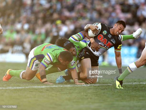 Dean Whare of the Panthers is tackled during the round 21 NRL match between the Penrith Panthers and the Canberra Raiders at Panthers Stadium on...