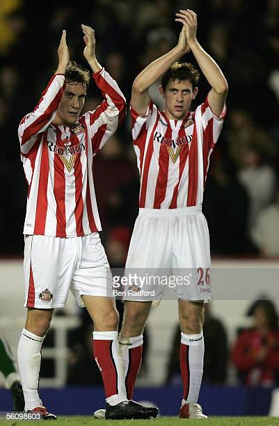 Dean Whitehead and Daryl Murphy of Sunderland applaud the Sunderland fans after the Barclays Premiership match between Arsenal and Sunderland at...