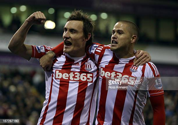 Dean Whitehead of Stoke celebrates with Michael Kightlt after scoring the first goal during the Barclays Premier League match between West Bromwich...
