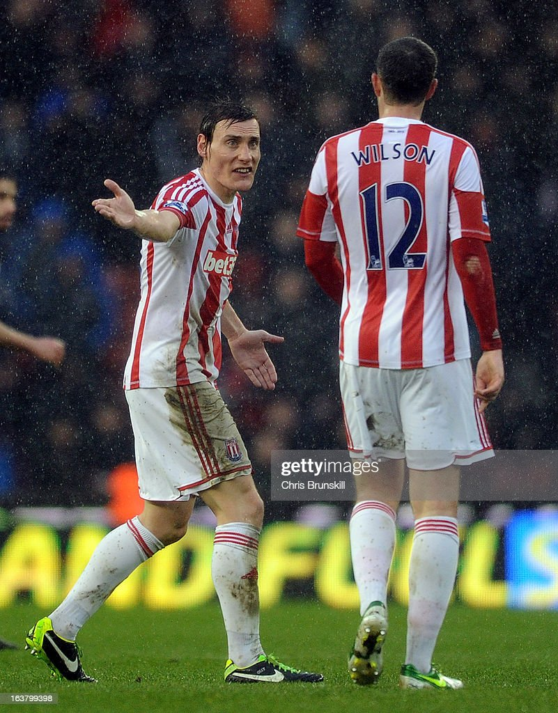 Dean Whitehead of Stoke City argues with team-mate Marc Wilson during the Barclays Premier League match between Stoke City and West Bromwich Albion at Britannia Stadium on March 16, 2013 in Stoke on Trent, England.