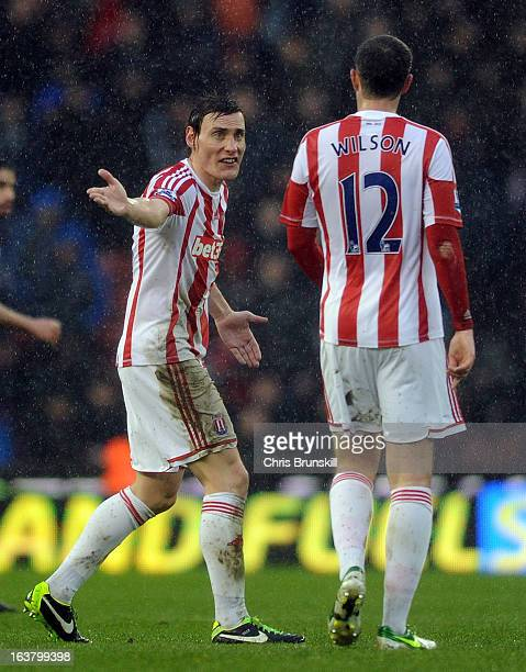 Dean Whitehead of Stoke City argues with teammate Marc Wilson during the Barclays Premier League match between Stoke City and West Bromwich Albion at...