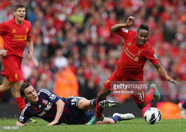 Dean Whitehead of Stoke City challenges Raheem Sterling of Liverpool during the Barclays Premier League match between Liverpool and Stoke City at...