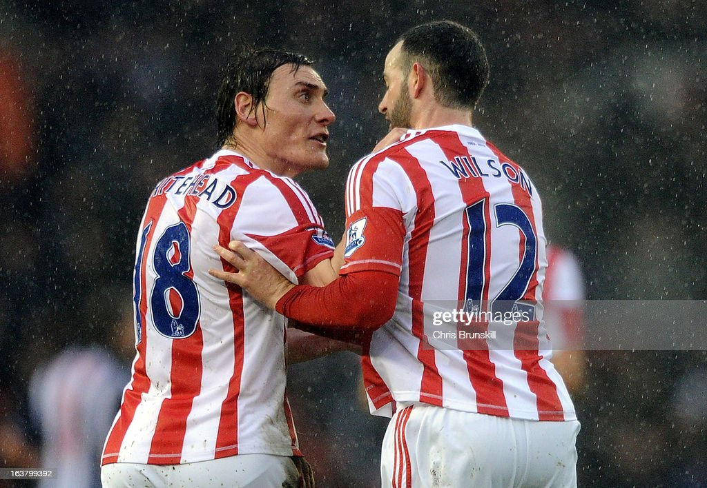 Dean Whitehead of Stoke City clashes with team-mate Marc Wilson during the Barclays Premier League match between Stoke City and West Bromwich Albion at Britannia Stadium on March 16, 2013 in Stoke on Trent, England.