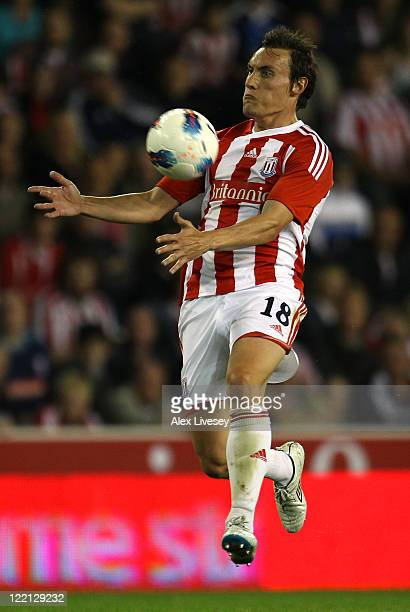 Dean Whitehead of Stoke City controls the ball during the UEFA Europa League playoff second leg match between Stoke City and FC Thun at the Britannia...