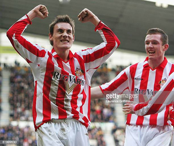 Dean Whitehead of Sunderland celebrates scoring the second goal with Stephen Elliott during the CocaCola Championship match between Derby County and...