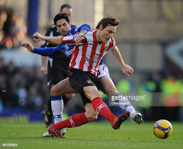Dean Whitehead of Sunderland is challenged by Mikel Arteta of Everton during the Barclays Premier League match between Everton and Sunderland at...
