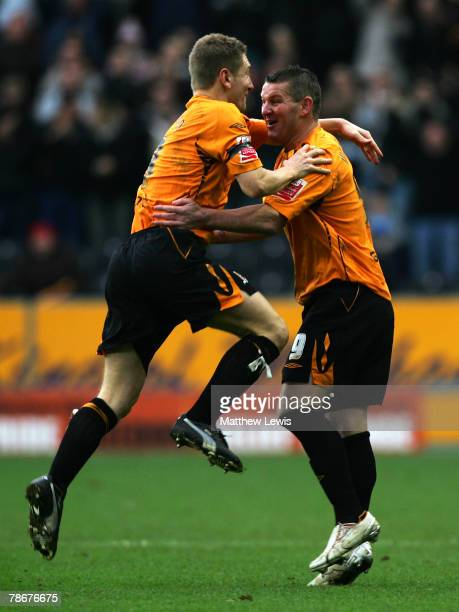 Dean Windass celebrates his goal with team mate Andy Dawson during the Coca-Cola Championship match between Hull City and Sheffield Wednesday at the...