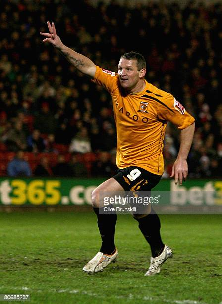 Dean Windass of Hull City celebrates scoring the third goal during the Coca-Cola Championship match between Barnsley and Hull City at Oakwell on...
