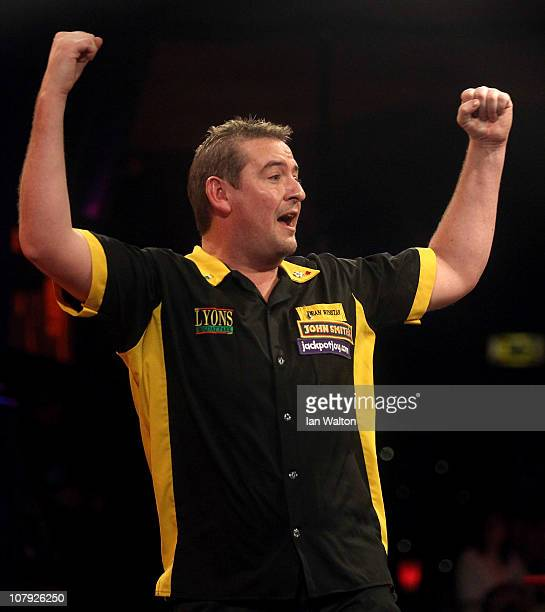 Dean Winstanley of England celebrates winning against Stephen Bunting of England during the Quarter Final match on January 7 2011 in Frimley England