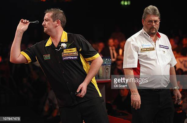 Dean Winstanley of England plays in the BDO World Darts Championship final against Martin Adams of England at the Lakeside Country Club on January 9...