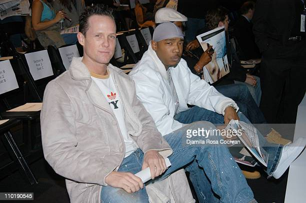 Dean Winters and Ja Rule during Olympus Fashion Week Fall 2004 Maurice Malone Front Row and Backstage at Studio Noir at Bryant Park in New York City...
