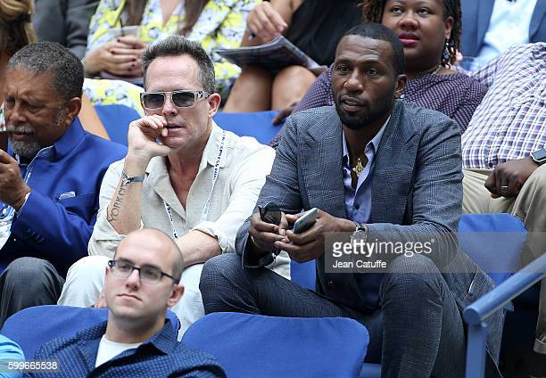 Dean Winters and Leon Robinson attend Venus and Serena Williams backtoback matches at Arthur Ashe Stadium on day 8 of the 2016 US Open at USTA Billie...