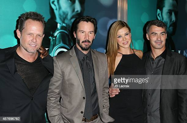 Dean Winters Keanu Reeves Adrianne Palicki and Chad Stahelski attend Summit Entertainment's premiere of 'John Wick' at the ArcLight Theater on...