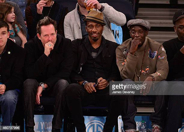 Dean Winters Leon Robinson and Michael K Williams attend New York Knicks vs Phoenix Suns game at Madison Square Garden on December 20 2014 in New...