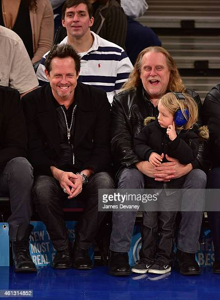 Dean Winters Warren Haynes and Hudson Haynes attend the Charlotte Hornets vs New York Knicks game at Madison Square Garden on January 10 2015 in New...