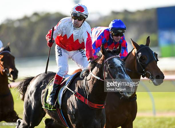 Dean Yendall riding Master of Arts celebrates on the line to win Race 8 the Warrnambool Cup during Grand Annual Day at Warrnambool Race Club on May 5...