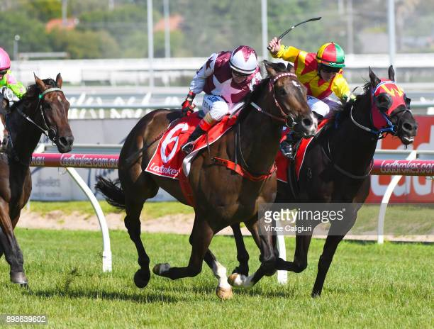 Dean Yendall riding Stella Collision defeats Patrick Moloney riding Oak Door in Race 7 Christmas Stakes during Melbourne Racing at Caulfield...