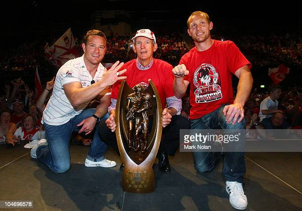 Dean Young of the Dragons Dragons coach Wayne Bennett and captain Ben Hornby pose for a photo with the NRL trophy during the St George Illawarra...