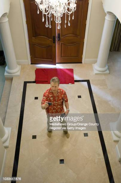Dean Zibas a real estate appraiser based in San Clemente stands in the grand entryway of an Anaheim Hills home listed for $239 million ///ADDITIONAL...
