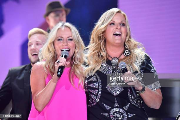 Deana Carter and Trisha Yearwood perform at the 2019 CMT Music Awards at Bridgestone Arena on June 05 2019 in Nashville Tennessee
