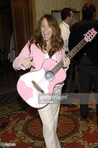 Deana Carter autographs a guitar for the silent auction