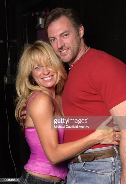 Deana Carter gets a hug from Darryl Worley backstage