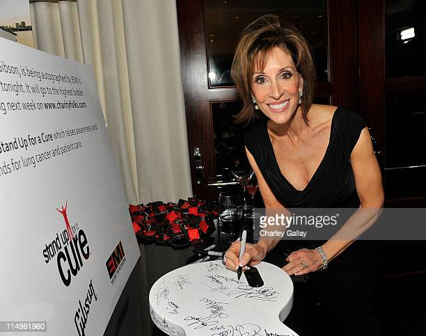 Deana Martin signs guitar donated by Gibson at the EMI/Stand Up For A Cure Post Grammy event held at SLS Beverly Hills Hotel on February 8, 2009 in...