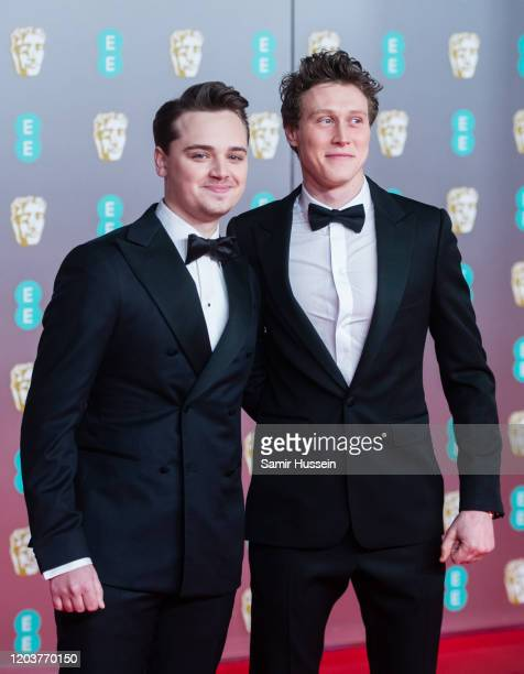 DeanCharles Chapman and George MacKay attend the EE British Academy Film Awards 2020 at Royal Albert Hall on February 02 2020 in London England