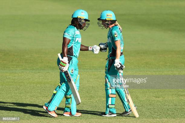 Deandra Dottin and Kirby Short of the Heat during the Women's Big Bash League match between the Brisbane Heat and the Perth Scorchers at Allan Border...