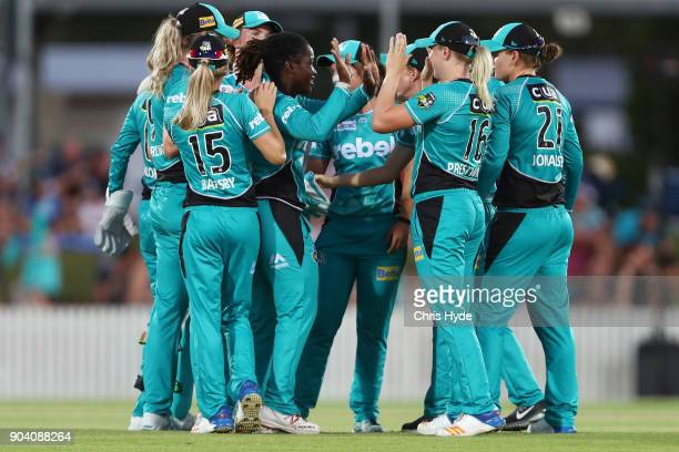 Deandra Dottin of the Heat celebrates dismissing Lizelle Lee of the Stars during the the Women's Big Bash League match between the Brisbane Heat and...