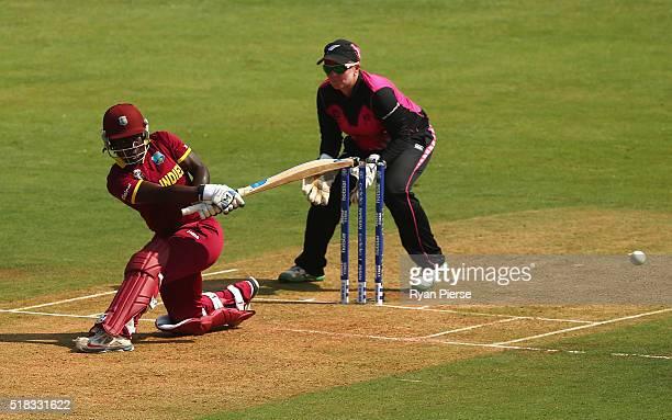 Deandra Dottin of the West Indies bats as Rachel Priest of New Zealand keeps wicket during the Women's ICC World Twenty20 India 2016 Semi Final match...