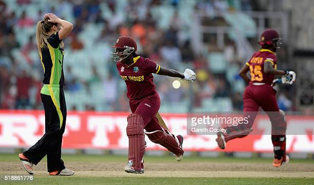 Deandra Dottin of the West Indies celebrates hitting the winning runs the Women's ICC World Twenty20 India 2016 Final between Australia and the West...