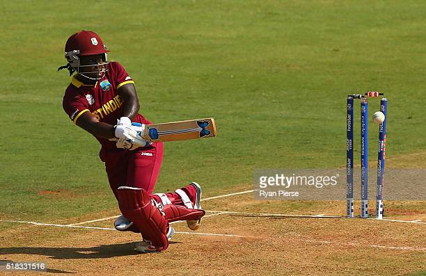 Deandra Dottin of the West Indies is bowled by Sophie Devine of New Zealand during the Women's ICC World Twenty20 India 2016 Semi Final match between...