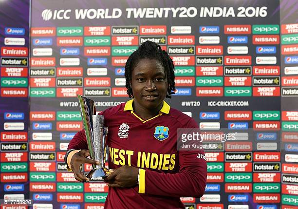 Deandra Dottin of the West Indies poses with the player of the match trophy during the Women's ICC World Twenty20 India 2016 match between West...
