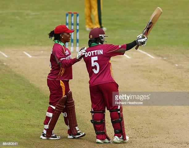 Deandra Dottin of West Indies celebrates reaching her half century with team mate Juliana Nero during the ICC Women's Twenty20 World Cup match...