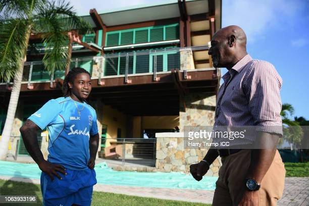 Deandra Dottin of West Indies chats with Sir Vivian Richards during a West Indies Net Session at Coolidge Cricket Ground on November 20, 2018 in...