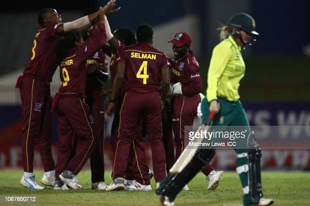 Deandra Dottin of West Indies is congratulated on running out Dane van Niekerk of South Africa during the ICC Women's World T20 2018 match between...
