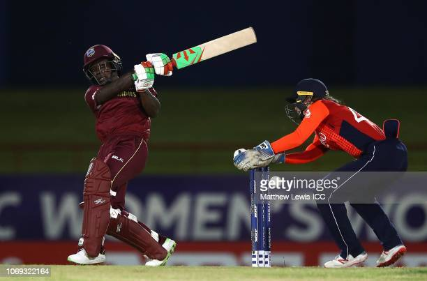 Deandra Dottin of West Indies pulls the ball towards the boundary asAmy Jones of England looks on during the ICC Women's World T20 2018 match between...